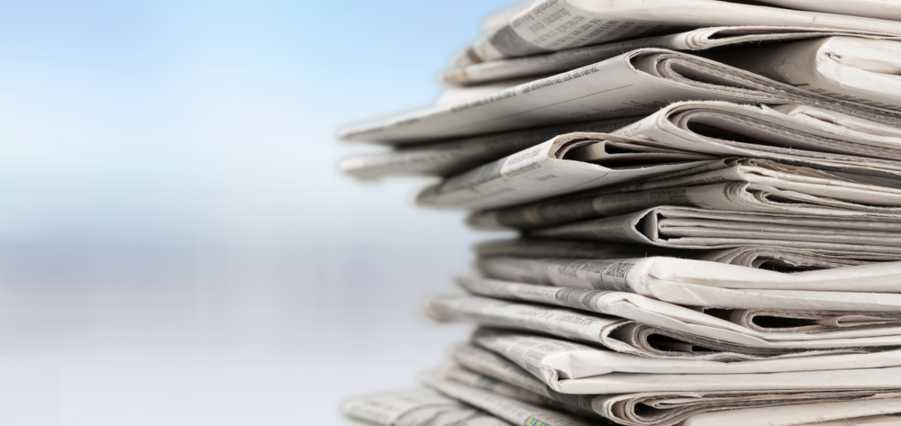This image has an empty alt attribute; its file name is newspapers.jpg